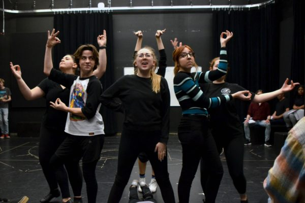 Savannah McCarter and the cast of Pippin rehearse a dance number.