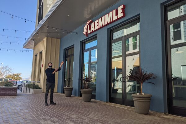 Cassie Gratton, Location Manager, gestures toward the front of the Laemmle Newhall theater